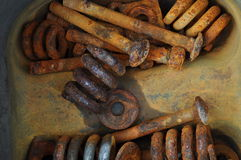 Rusted springs and bolts in a bucket Royalty Free Stock Photos