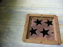 Rusted stars. Rusty metal elevator door with star cutouts stock photos