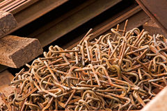 Rusted Steel Clips. Salvaged steel fastenings used in securing the base plates to ties on railroad tracks Royalty Free Stock Photos