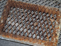 Rusted steel drain grate Royalty Free Stock Photo