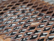 Rusted steel drain grate Royalty Free Stock Images