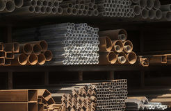 Rusted steel pipes and rectangle tubes piles Royalty Free Stock Images