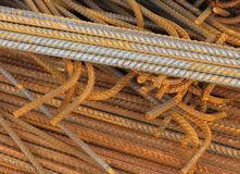 Rusted steel reinforcing rods. Pile of rusting steel reinforcing rods used in construction Royalty Free Stock Image