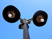 Rusted Street light lamppost. Street light lamppost,Street light lamppost isolated in blue sky background ,rusted  Street light lamppost Stock Image