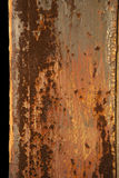 Rusted Texture on Steel. Closeup of the rusted texture on an outdoor steel pole. Vertical shot Stock Photos