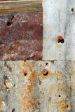 Rusted tin and nails Royalty Free Stock Images