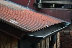 Rusted tin roof with gutter royalty free stock photography