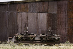 Rusted train car wheels and shed Stock Photos