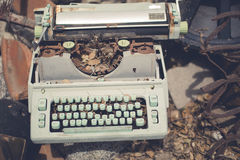 Rusted Typewriter. Old typewriter machine in art/scrap yard. Well rusted and aged patina Stock Photos