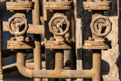 Rusted valves and pipes Stock Photo