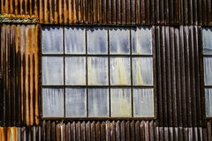 Rusted warehouse and dirty windows in Cass West Virginia royalty free stock photos