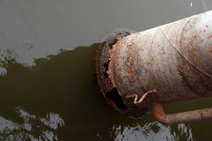 Rusted water pump pipe in water royalty free stock photos