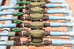 Rusted Water Valves and Old Water meters Royalty Free Stock Photo