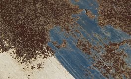 Rusted and weathered paint on textured metal.Abstract background. And pattern for design Royalty Free Stock Photos