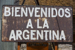 Rusted welcome to Argentina sign written in Spanish. Rusted old retro sign saying welcome to Argentina written in Spanish at old train station at the border of Royalty Free Stock Photos