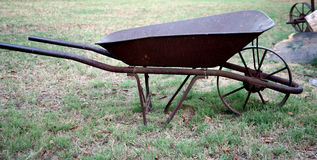 Rusted wheelbarrow. On the grass royalty free stock photography