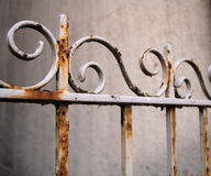 Rusted white fence. A white fence which has become rusty through years of neglect Stock Photography