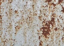 Rusted white painted metal wall. Rusty metal background with streaks of rust. Rust stains. The metal surface rusted spots.  stock image