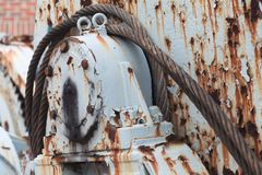 Rusted winch reel with steel rope, close up Royalty Free Stock Photos