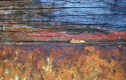 Rusted Wood and Iron. Interesting texture and colors from antique rusted wood panels and iron slab Royalty Free Stock Images
