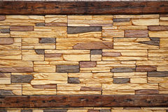Rusted Wood and Stone Masonry Wall Royalty Free Stock Image