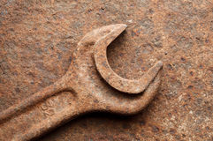 Rusted wrench over corroded iron plate Stock Images