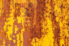 Rusted yellow painted metal. Abstract texture matal background. Royalty Free Stock Photo