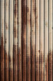 Rusted zinc fence. Rusted green zinc fence in sunny day Royalty Free Stock Photos