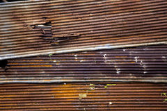 Rusted zinc steel sheet, there is not rusted all the sheet some area still no rusted created it created pattern. royalty free stock photo