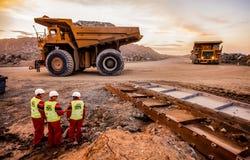 Large Dump Trucks transporting Platinum palladium stock images