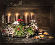 Rustic Advent wreath with four burning candles and traditional cookie Royalty Free Stock Images