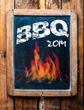 Rustic advertisement for a BBQ on a slate. Rustic advertisement for a BBQ on a vintage kids school slate with a picture of red hot flames and an annotation at stock photography