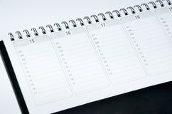 Rustic agenda. With metal spiral and marked dates and hours Stock Photo