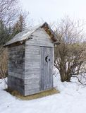 Rustic Alaskan outhouse Stock Photo