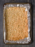 Rustic almond florentine biscuit on baking sheet Stock Photos