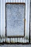 Rustic aluminium door. Old weathered rustic aluminium door Royalty Free Stock Image