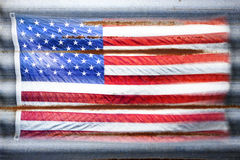 Rustic American Flag Stars Stripes Background. An american flag on a corrugated iron background Royalty Free Stock Images