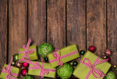 Rustic and antique wooden background with red and green christma Royalty Free Stock Photo