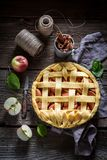 Rustic apple pie made of fresh ingredients Stock Images