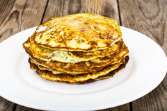 Rustic Autumn Meal Pancakes from Zucchini. Vegetarian Diets. Studio Photography on Gray Wooden Background royalty free stock images