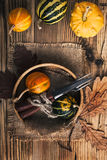 Rustic autumn place setting with miniature pumpkins on a rustic Stock Photo