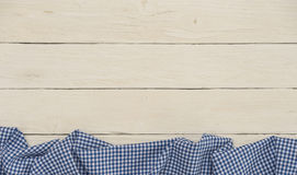 Rustic backdrop. With white wooden boards and blue checkered table cloth Royalty Free Stock Photo