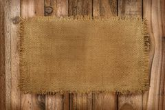 Rustic background of Burlap material on a wooden table with copy royalty free stock photos