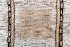 Rustic background with burlap, rope and chain Stock Photos