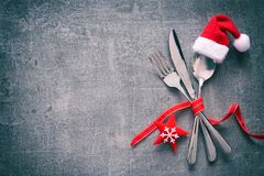 Christmas dinner table place setting with Santas hat royalty free stock photos