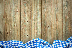 Rustic background for Oktoberfest. With bavarian white and blue fabric Stock Photography