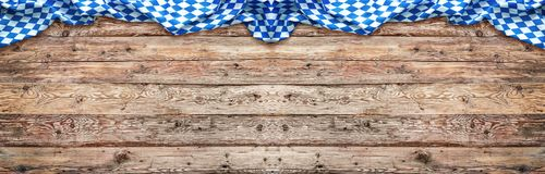 Rustic background for Oktoberfest with bavarian flag. Rustic background for Oktoberfest with bavarian white and blue fabric royalty free stock photography