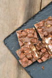 Rustic background with rocky road dessert squares. Rocky road squares on rustic background Royalty Free Stock Images