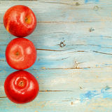 Rustic background three red apples Royalty Free Stock Photos