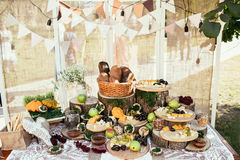 Rustic bagging candy bar set up on wedding ceremony place. Rustic bagging candy bar set up on wedding ceremony at sunny day Royalty Free Stock Photo
